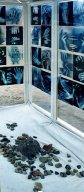 "steine1b.jpg - Detail : Plexiglass - Wood House, 180 x 160 x 70 cm with 80 Transparent C- Prints 29 x 21 cm ""Steine Ohne Grenzen I"" K"